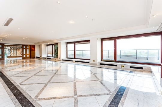 The three-storey penthouse, in St John???s Wood, London which has been put on sale for a staggering ??10million. See SWNS story SWBRproperty; One of Britain???s largest apartments has been put on the market for almost ??10 million - and it has an 85FT long entertaining suite. The three-storey penthouse, in St John???s Wood, London, has stunning views across Regent???s Park. It is in ???unmodernised??? condition but boasts nine bedrooms, five bathrooms and four reception rooms. The triplex, which is the second largest apartment currently for sale on the open market in London, also has an incredible 4,125 sq/ft of terraces and balconies with views across the capital???s skyline.