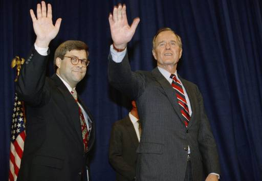 In this Nov. 26, 1991, file photo, President George H.W. Bush, right, and William Barr wave after Barr was sworn in as the new Attorney General of the United States at a Justice Department ceremony in Washington.