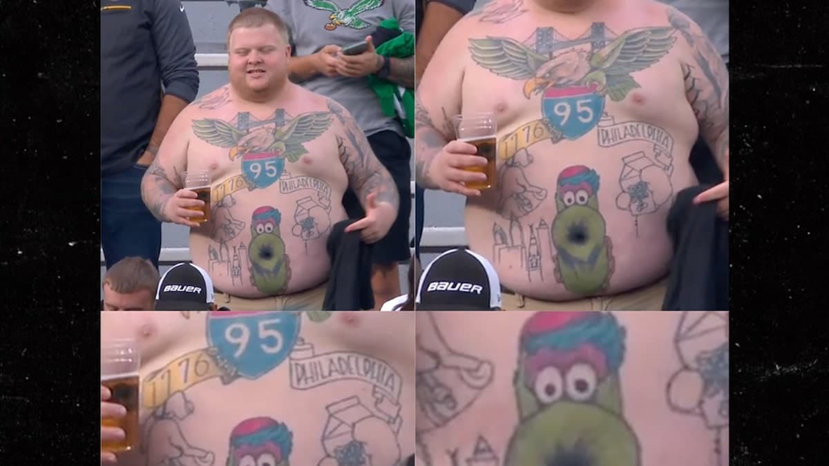 Glorious phanatic belly button tattoo at Packers game Eagles Fan Shows