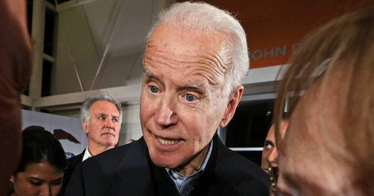 Democratic presidential candidate and former Vice President Joe Biden talks to people who came to his campaign event at the FFA Enrichment Center in Ankeny, Iowa, on Jan. 25, 2020.