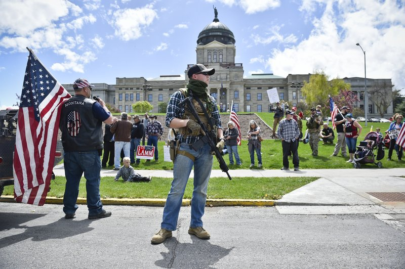 Guns in capitol buildings divide states following armed demonstrations