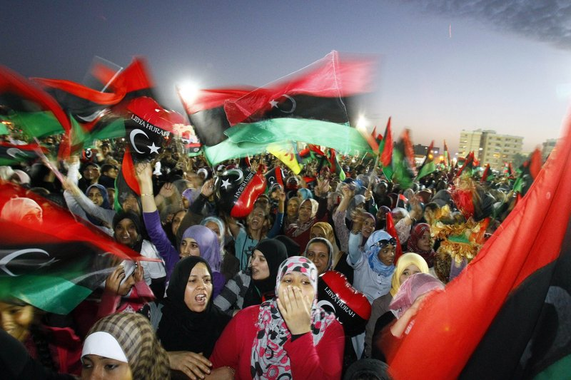 Libyans mark the revolt in 2011 with eyes on the transitional government