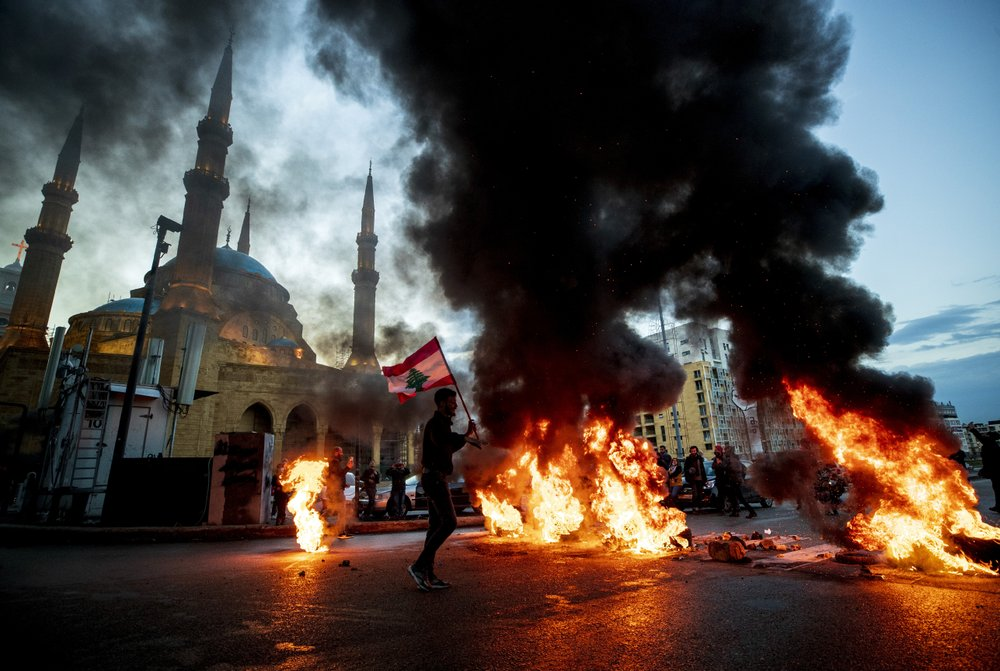 Lebanon's demonstrators give a grim, angry message by burning tires.