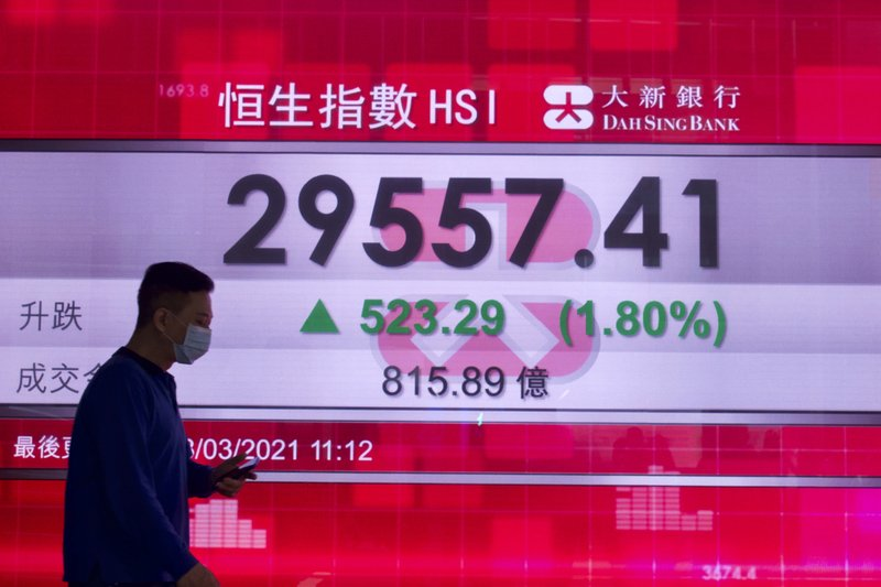 World stocks have risen in tandem with Wall Street in response to the Fed's promise to raise interest rates.