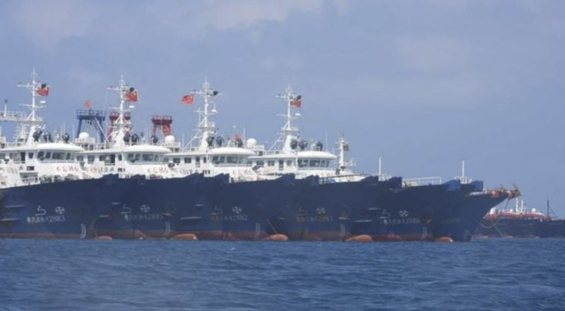 Philippine defense chief has requested that the Chinese flotilla leave the reef.
