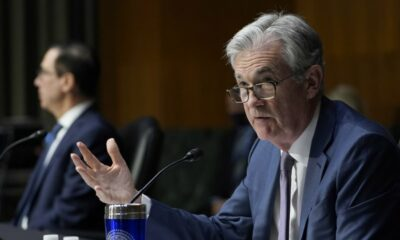 Powell claims that the economy is improving, but that the Fed's assistance is still needed.