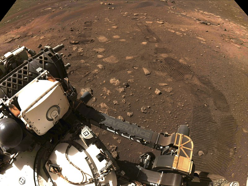 NASA's new Mars rover makes its first trip down a dusty red path, covering 21 feet.