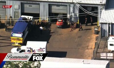 Co-workers rescue man trapped under fallen truck