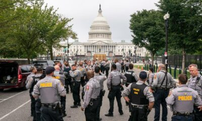 Heavy police presence as protesters trickle in for DC rally