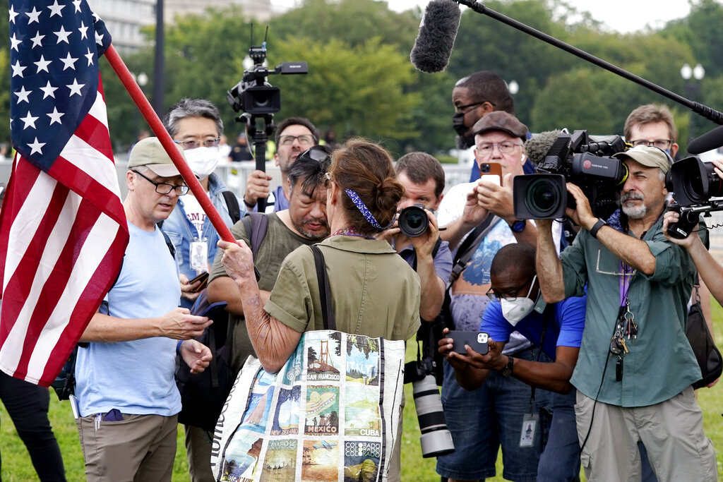 Trickle of protesters at DC rally outnumbered by media, police