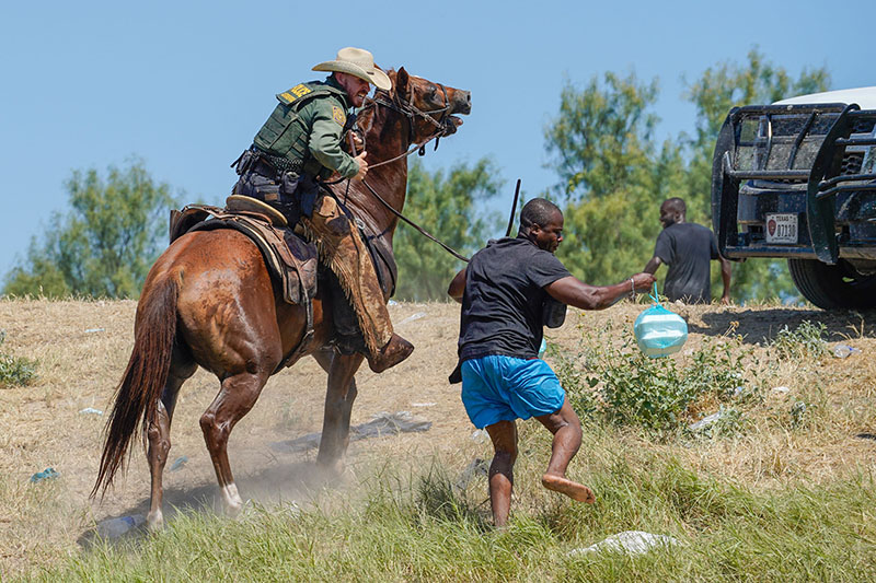 1632143034 156 Outrage as border agents on horseback round up Haitians for