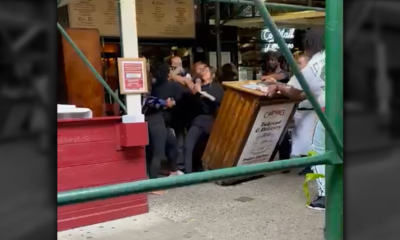 Protesters target NYC restaurant for row over vaccination card