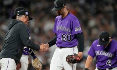Rockies clinch another losing season, while power-hitting Giants win 100th game