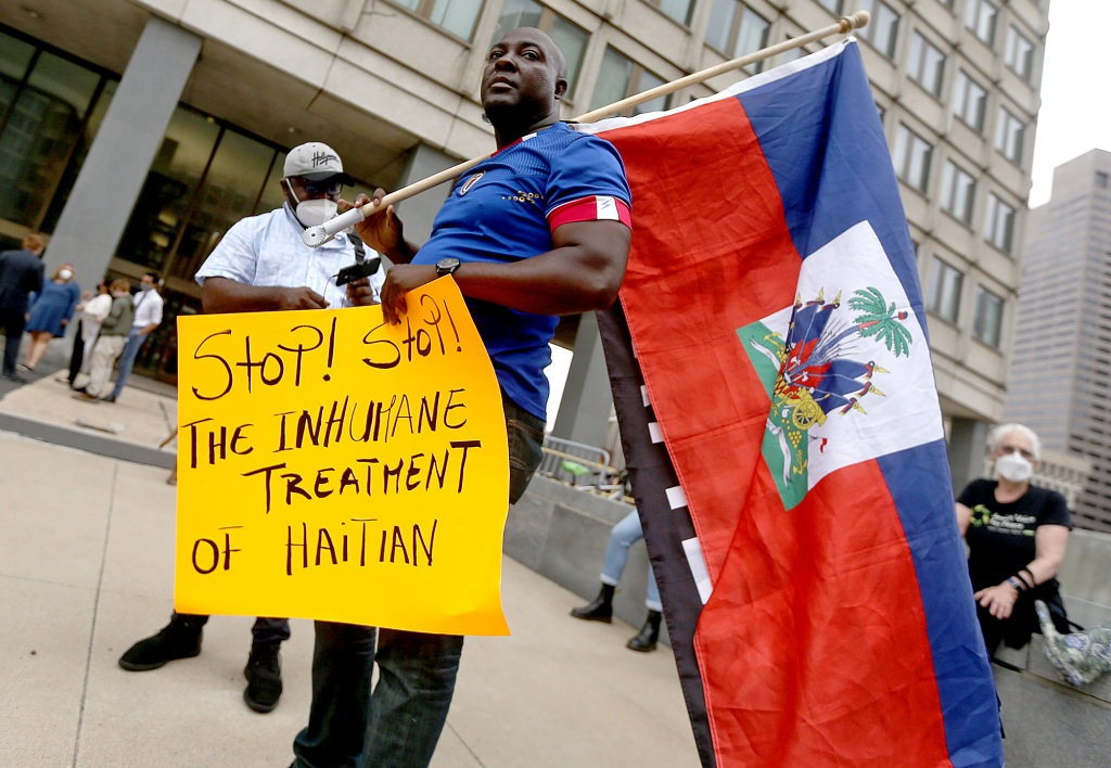 Protesters gather in Boston to oppose treatment of Haitians at the border