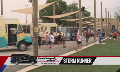 Threat of showers doesn't stop walkers, Cardinals fans from getting outside