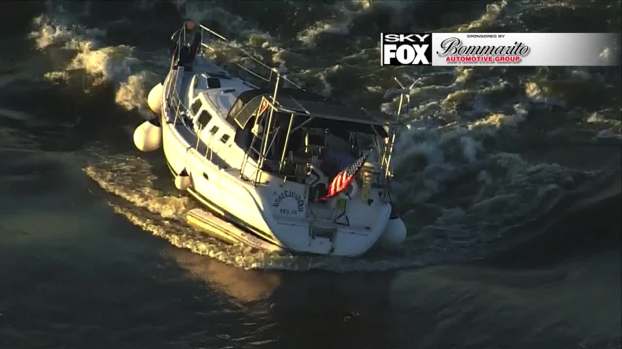 Boat still stuck on the Mississippi's Chain of Rocks after a week