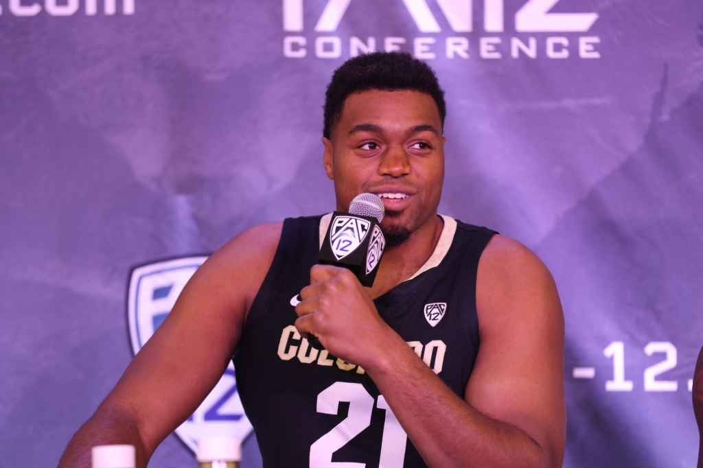 """""""The Governor"""" Evan Battey a coach on the floor for CU Buffs men's basketball"""