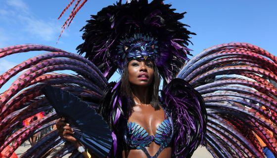 Dem Tings Tingin': A Gallery Of Feathered Baddies Who Stunned At Miami Carnival 2021